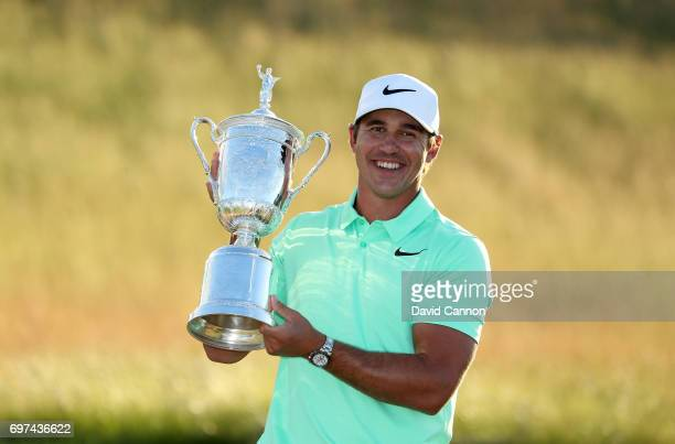 Brooks Koepka of the United States holds the USOpen trophy after his four shot win in the final round of the 117th US Open Championship at Erin Hills...