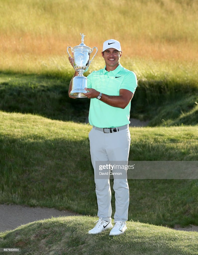 Brooks Koepka of the United States holds the U.S.Open trophy after his four shot win in the final round of the 117th US Open Championship at Erin Hills on June 18, 2017 in Hartford, Wisconsin.