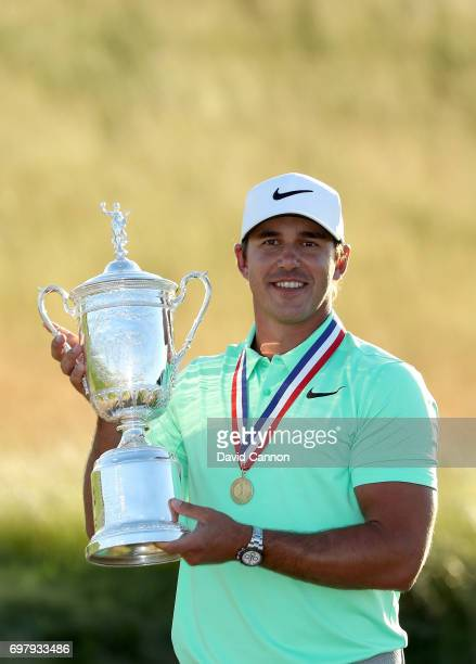 Brooks Koepka of the United States holds the USOpen trophy wearing the Jack Nicklaus medal after his four shot win in the final round of the 117th US...