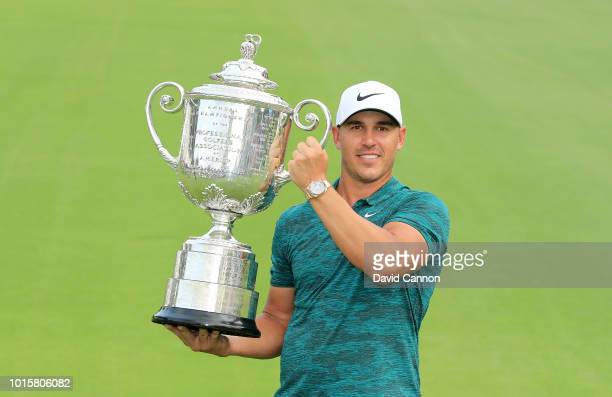 Brooks Koepka of the United States holds the Wannamaker Trophy after his two stroke victory the final round of the 100th PGA Championship at the...
