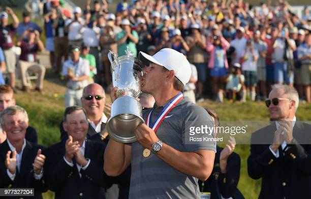 Brooks Koepka of the United States kisses the U.S. Open Championship trophy during the trophy presentation after winning the 2018 U.S. Open at...