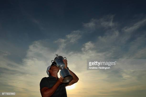 Brooks Koepka of the United States kisses the US Open Championship trophy after winning the 2018 US Open at Shinnecock Hills Golf Club on June 17...