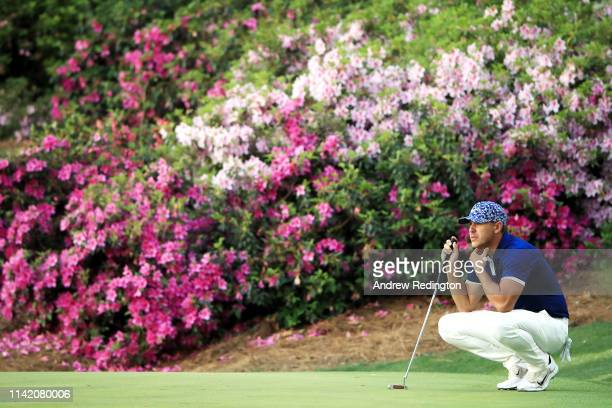 Brooks Koepka of the United States lines up a putt on the 13th green during the first round of the Masters at Augusta National Golf Club on April 11...