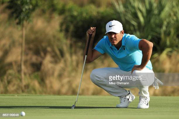 Brooks Koepka of the United States lines up a putt on the 14th green during the first round of the Hero World Challenge at Albany Bahamas on November...
