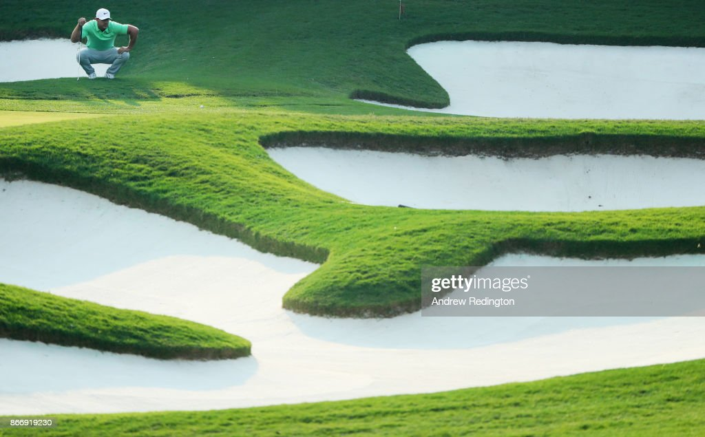 Brooks Koepka of the United States lines up a putt on the 15th green during the second round of the WGC - HSBC Champions at Sheshan International Golf Club on October 27, 2017 in Shanghai, China.