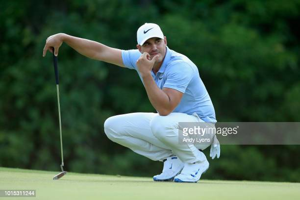 Brooks Koepka of the United States lines up a putt on the 17th green during the third round of the 2018 PGA Championship at Bellerive Country Club on...