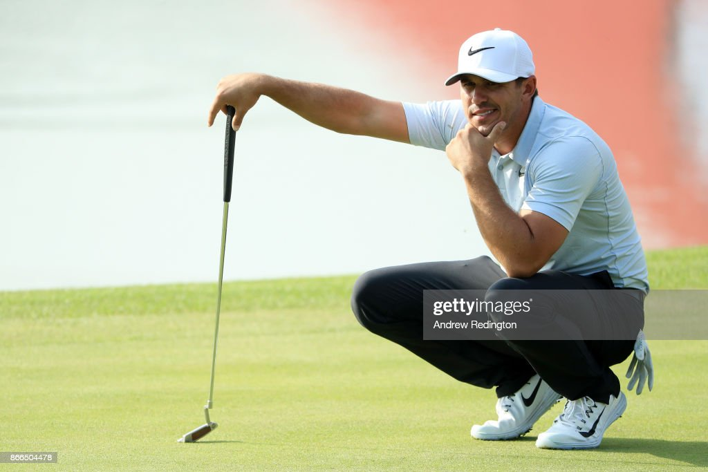 Brooks Koepka of the United States lines up a putt on the ninth green during the first round of the WGC - HSBC Champions at Sheshan International Golf Club on October 26, 2017 in Shanghai, China.