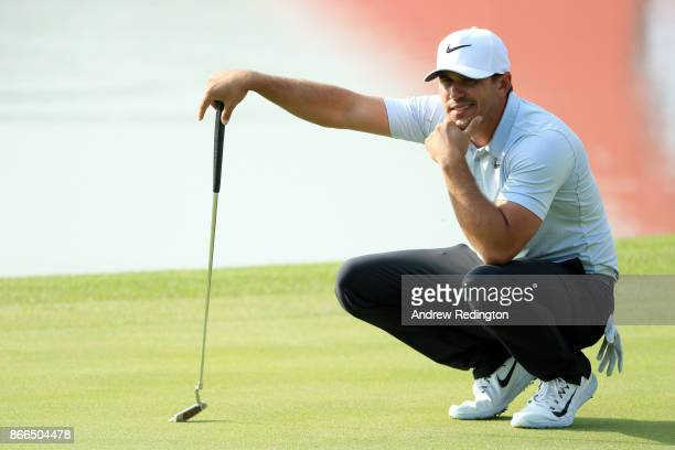 Brooks Koepka of the United States lines up a putt on the ninth green during the first round of the WGC HSBC Champions at Sheshan International Golf...