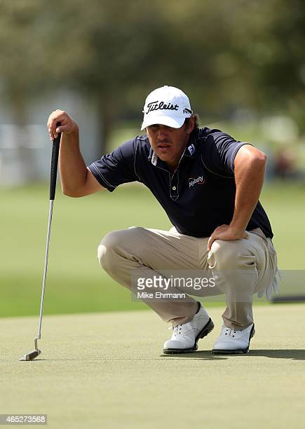 Brooks Koepka of the United States lines up a putt on the tenth green during the first round of the World Golf Championships-Cadillac Championship at...