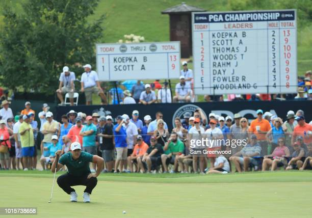 Brooks Koepka of the United States lines up a putt on the third green during the final round of the 2018 PGA Championship at Bellerive Country Club...