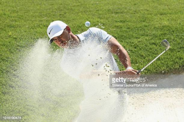 Brooks Koepka of the United States plays a shot from a bunker on the sixth hole during the third round of the 2018 PGA Championship at Bellerive...