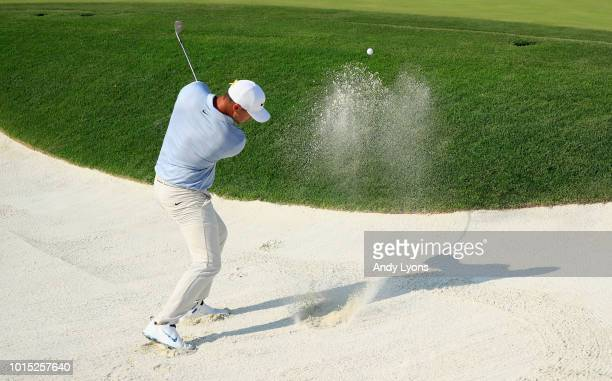 Brooks Koepka of the United States plays a shot from a bunker on the 14th hole during the third round of the 2018 PGA Championship at Bellerive...