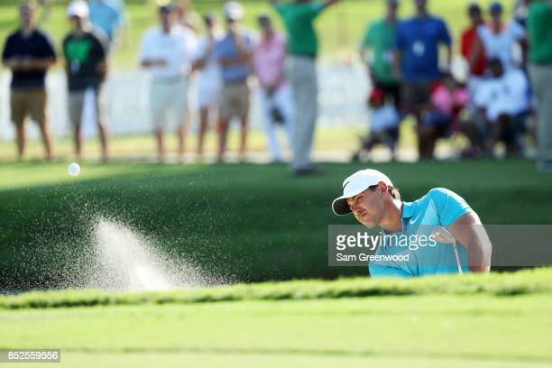 Brooks Koepka of the United States plays a shot from a bunker on the 15th hole during the third round of the TOUR Championship at East Lake Golf Club...