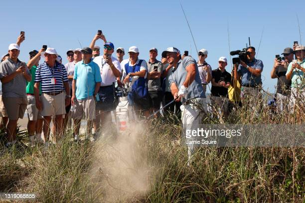 Brooks Koepka of the United States plays a shot from the sand on the 15th hole during the first round of the 2021 PGA Championship at Kiawah Island...