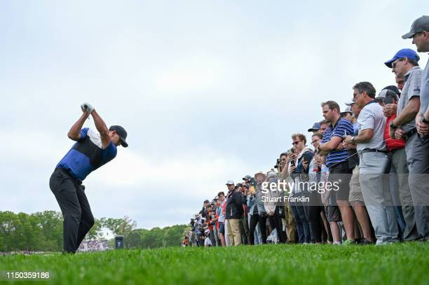Brooks Koepka of the United States plays a shot on the 12th hole during the final round of the 2019 PGA Championship at the Bethpage Black course on...