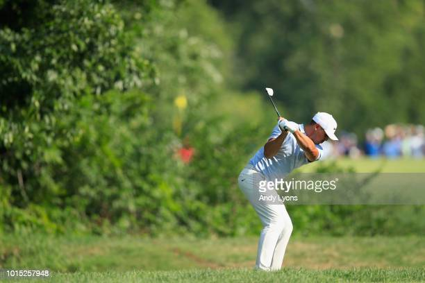 Brooks Koepka of the United States plays a shot on the 14th hole during the third round of the 2018 PGA Championship at Bellerive Country Club on...