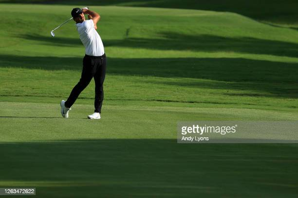 Brooks Koepka of the United States plays a shot on the 18th hole during the final round of the World Golf Championship-FedEx St Jude Invitational at...