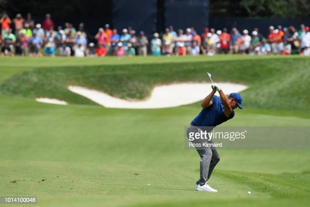 Brooks Koepka of the United States plays a shot on the fifth hole during the first round of the 2018 PGA Championship at Bellerive Country Club on...