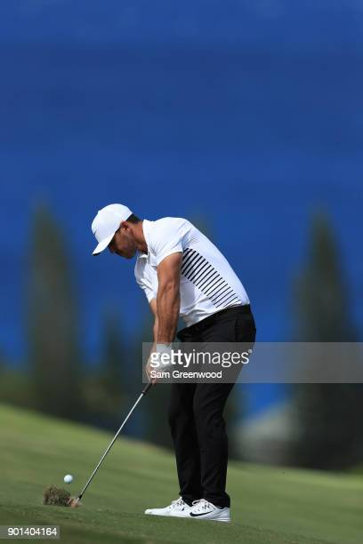Brooks Koepka of the United States plays a shot on the fourth hole during the first round of the Sentry Tournament of Champions at Plantation Course...