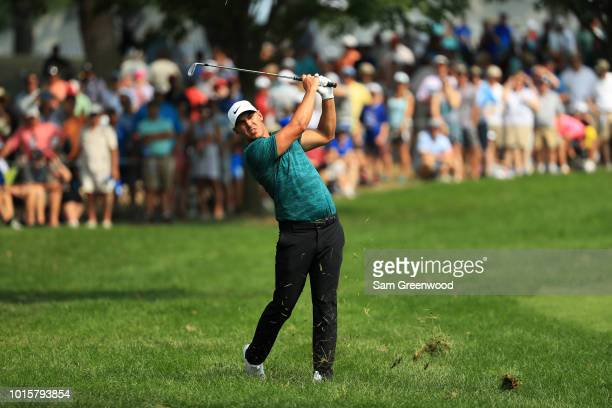 Brooks Koepka of the United States plays a shot on the tenth hole during the final round of the 2018 PGA Championship at Bellerive Country Club on...
