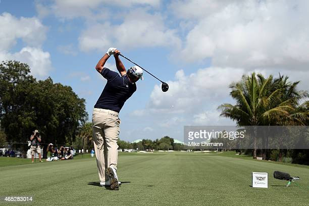 Brooks Koepka of the United States plays a tee shot on the twelfth hole during the first round of the World Golf Championships-Cadillac Championship...