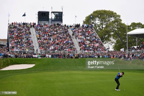 Brooks Koepka of the United States plays a third shot on the 18th hole during the final round of the 2019 PGA Championship at the Bethpage Black...