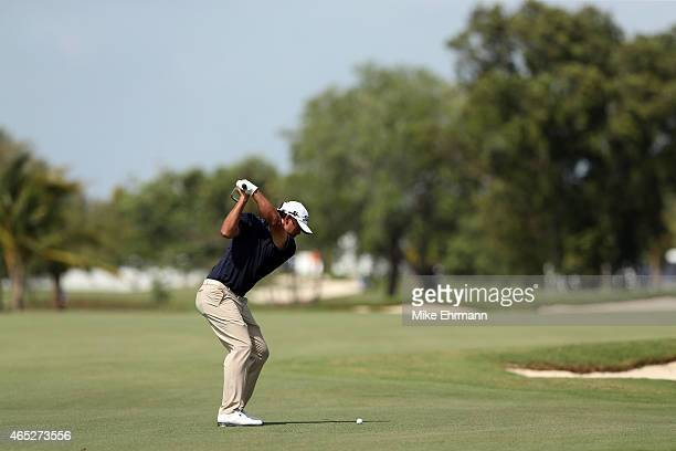 Brooks Koepka of the United States plays an approach shot to the tenth green during the first round of the World Golf Championships-Cadillac...