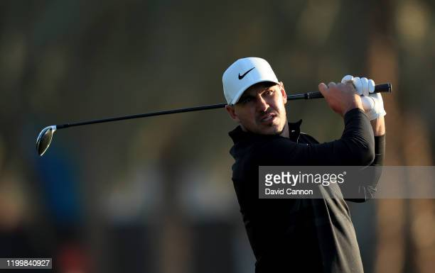 Brooks Koepka of the United States plays his second shot on the 10th hole during the first round of the Abu Dhabi HSBC Championship at Abu Dhabi Golf...