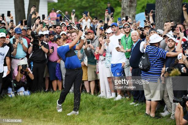 Brooks Koepka of the United States plays his second shot on the 13th hole during the final round of the 2019 PGA Championship at the Bethpage Black...