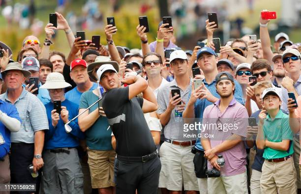 Brooks Koepka of the United States plays his second shot on the first hole during the final round of the TOUR Championship at East Lake Golf Club on...
