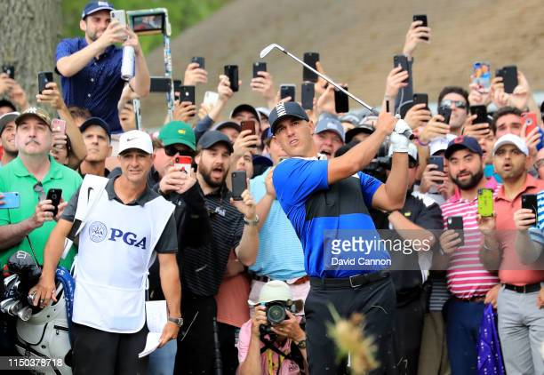 Brooks Koepka of the United States plays his second shot on the par 5 13th hole during the final round of the 2019 PGA Championship on the Black...