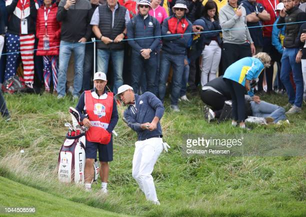 Brooks Koepka of the United States plays his second shot on the sixth hole after his tee shot struck a spectator during the morning fourball matches...