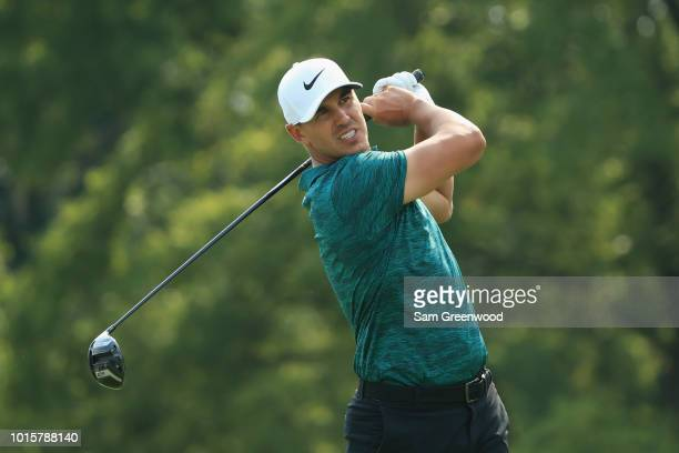 Brooks Koepka of the United States plays his shot from the 12th tee during the final round of the 2018 PGA Championship at Bellerive Country Club on...