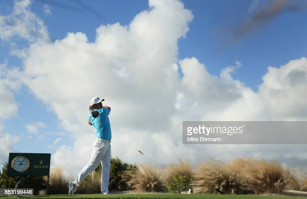 Brooks Koepka of the United States plays his shot from the 14th tee during the first round of the Hero World Challenge at Albany Bahamas on November...