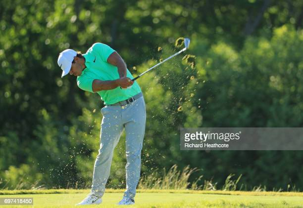 Brooks Koepka of the United States plays his shot from the 16th tee during the final round of the 2017 US Open at Erin Hills on June 18 2017 in...