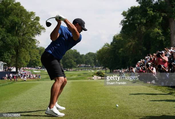 Brooks Koepka of the United States plays his shot from the 17th tee during a practice round prior to the 2018 PGA Championship at Bellerive Country...