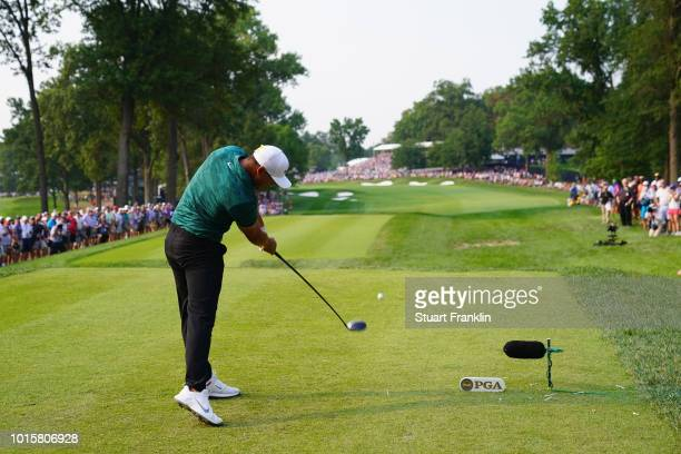 Brooks Koepka of the United States plays his shot from the 18th tee during the final round of the 2018 PGA Championship at Bellerive Country Club on...