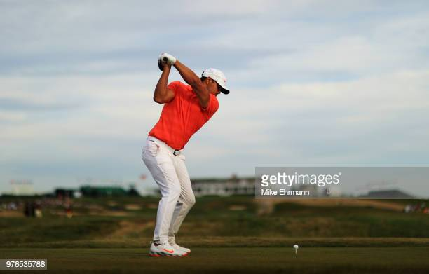 Brooks Koepka of the United States plays his shot from the 18th tee during the third round of the 2018 U.S. Open at Shinnecock Hills Golf Club on...