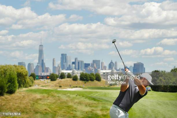 Brooks Koepka of the United States plays his shot from the tenth tee during the final round of The Northern Trust at Liberty National Golf Club on...