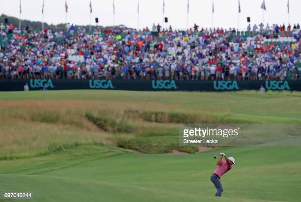 Brooks Koepka of the United States plays his shot on the 18th hole during the third round of the 2017 US Open at Erin Hills on June 17 2017 in...
