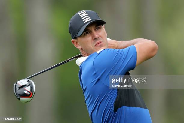 Brooks Koepka of the United States plays his tee shot on the 12th hole during the final round of the 2019 PGA Championship on the Black Course at...