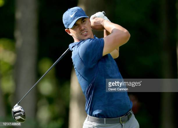 Brooks Koepka of the United States plays his tee shot on the 17th hole during the first round of the 100th PGA Championship at the Bellerive Country...