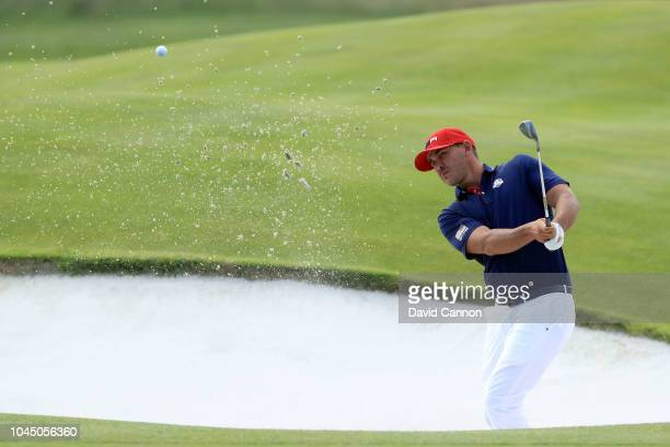 Brooks Koepka of the United States plays his third shot on the 18th hole in his match against Paul Casey of the European Team during the final day...
