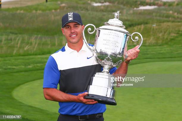 Brooks Koepka of the United States poses for photos after winning the 2019 PGA Championship at the Bethpage Black course with a score of 8 under par...