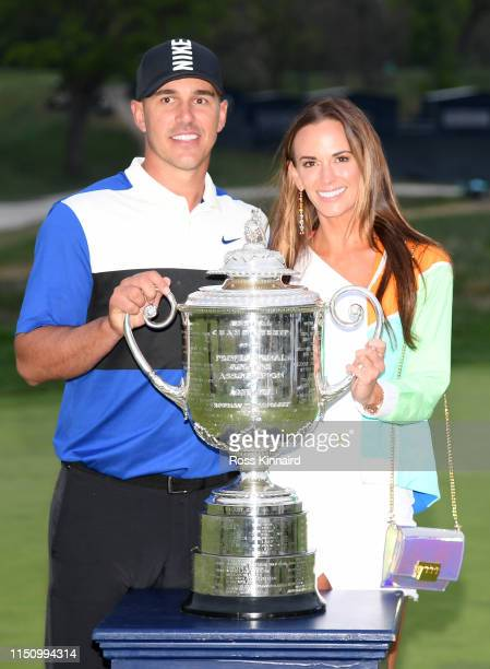 Brooks Koepka of the United States poses with girlfriend Jena Sims and the Wanamaker Trophy during the Trophy Presentation Ceremony after winning the...