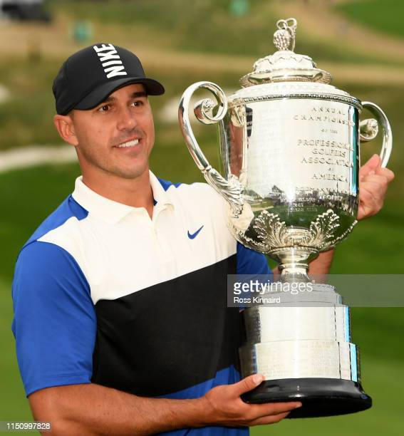 Brooks Koepka of the United States poses with the Wanamaker Trophy during the Trophy Presentation Ceremony after winning the final round of the 2019...