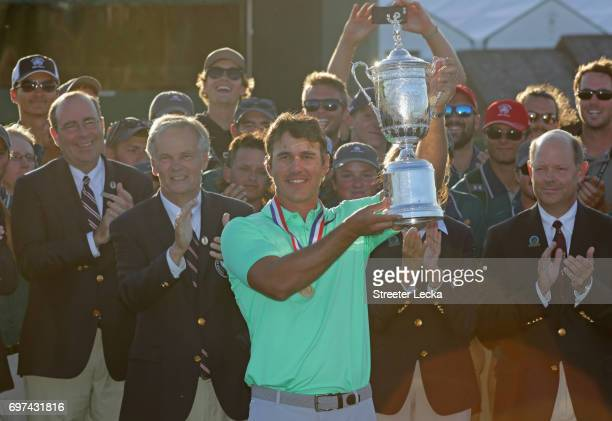 Brooks Koepka of the United States poses with the winner's trophy after his victory at the 2017 US Open at Erin Hills on June 18 2017 in Hartford...