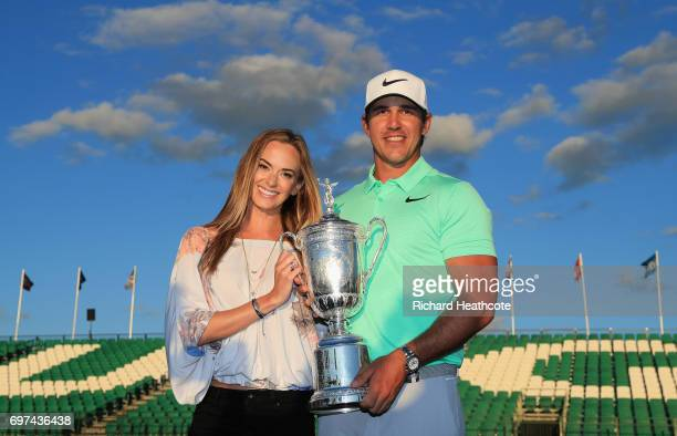Brooks Koepka of the United States poses with the winner's trophy with Jena Sims after his victory at the 2017 US Open at Erin Hills on June 18 2017...