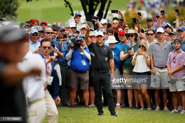 Brooks Koepka of the United States prepares to play his second shot on the first hole during the final round of the TOUR Championship at East Lake...