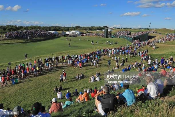 Brooks Koepka of the United States putts on the 17th green during the final round of the 2017 U.S. Open at Erin Hills on June 18, 2017 in Hartford,...